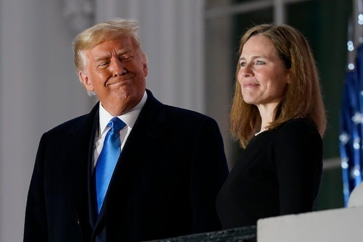 President Donald Trump and Amy Coney Barrett stand on the Blue Room Balcony after Supreme Court Justice Clarence Thomas…