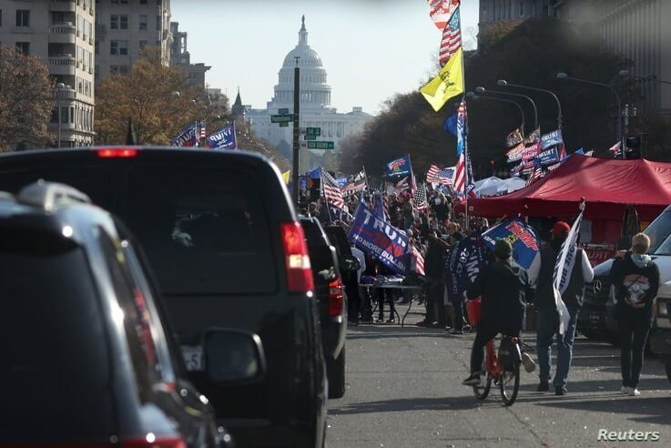 Supporters of U.S. President Donald Trump cheer alongside his presidential motorcade at Freedom Plaza near the White House in Washington, Nov. 14, 2020.
