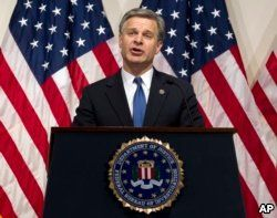 FBI Director Christopher Wray speaks during a news conference on the inspector general's report at FBI headquarters on June 14, 2018, in Washington.