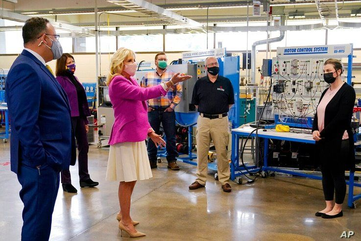 First lady Jill Biden, third from left, speaks during a visit with Education Secretary Miguel Cardona, left, to Sauk Valley…
