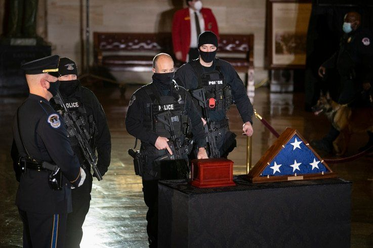 U.S. Capitol Police officers pay their respects to U.S. Capitol Police officer Brian Sicknick as an urn with his cremated…