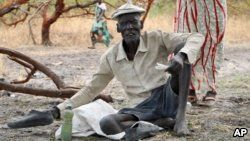 Gatdin Bol, 65, who fled fighting and now survives by eating fruit from the trees, sits under a tree in the town of Kandak, South Sudan. Five years into South Sudan's civil war more than 7 million people are facing severe hunger without food aid, according to the latest analysis by the U.N. and the government.