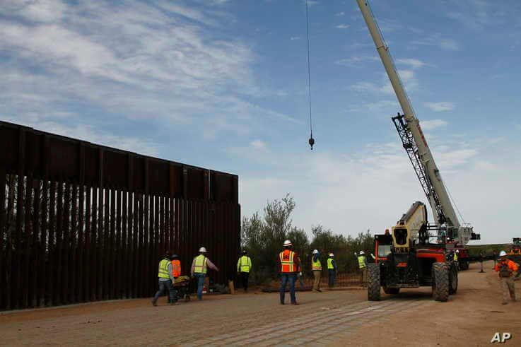 Workers break ground on new border wall construction about 20 miles west of Santa Teresa, New Mexico, Aug. 23, 2019.