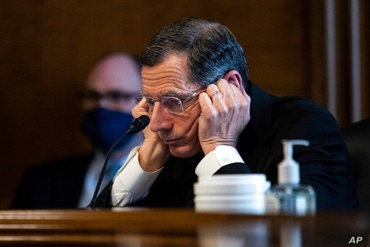Senator John Barrasso, R-WY,  listens to Rep. Deb Haaland, D-N.M., during a confirmation hearing before the Senate Committee on…