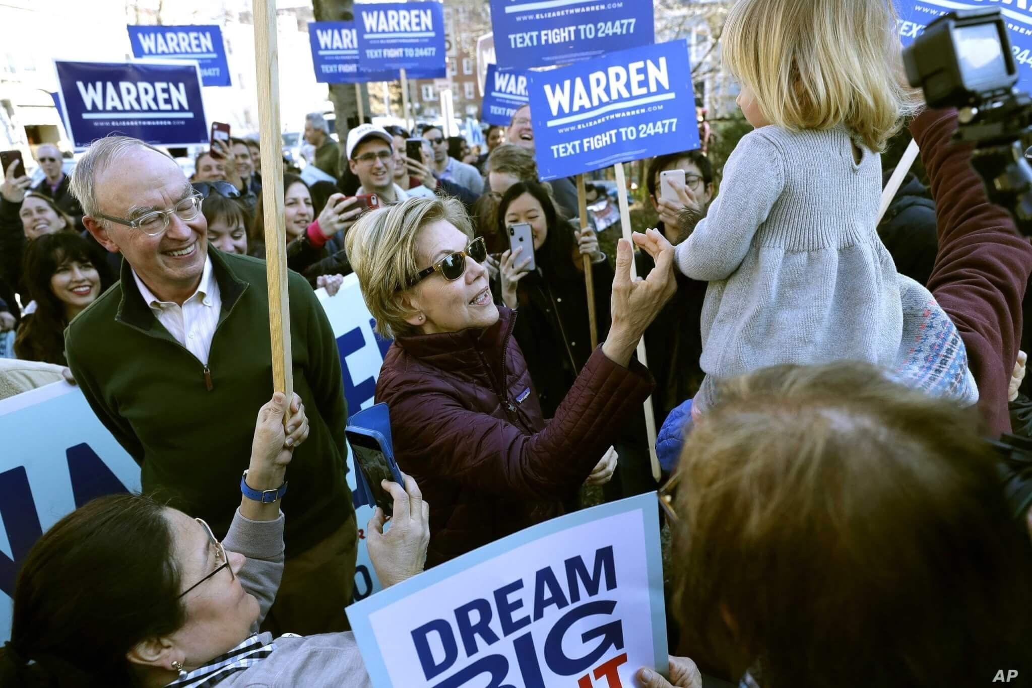 Democratic presidential candidate Sen. Elizabeth Warren, D-Mass., greets a young supporter