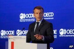 French President Emmanuel Macron delivers a speech at the OECD ministerial council meeting in Paris, May 30, 2018.
