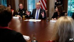 President Donald Trump speaks during a roundtable on immigration policy in California, in the Cabinet Room of the White House, May 16, 2018, in Washington.