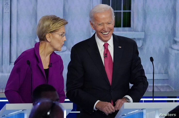 Democratic presidential candidate and Senator Elizabeth Warren talks with former Vice President Joe Biden during a break at the…