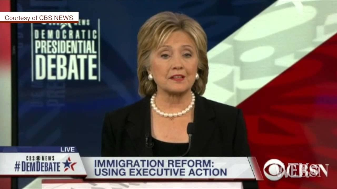 Clinton says she'll go further on immigration reform