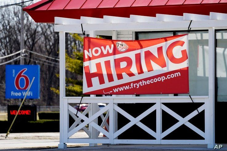 A hiring sign shows outside of restaurant in Prospect Heights, Illinois, March 21, 2021.