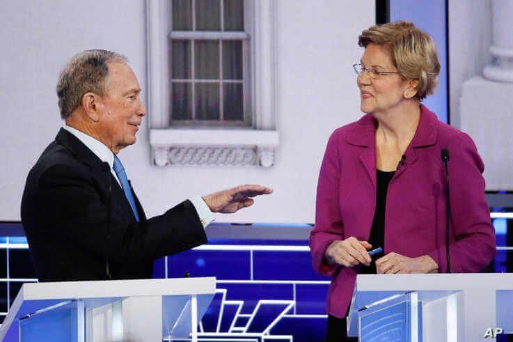Democratic presidential candidates, former New York City Mayor Mike Bloomberg, left, and Sen. Elizabeth Warren, D-Mass., talk…
