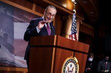 Senate Majority Leader Chuck Schumer, D-N.Y., praises his Democratic Caucus at a news conference just after the Senate narrowly…