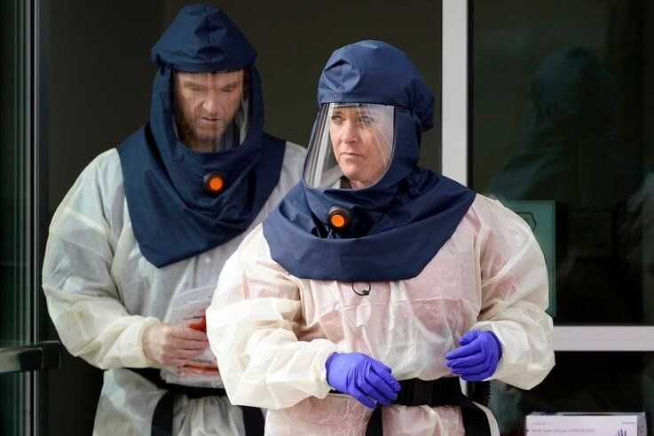 FILE - In this Oct. 23, 2020, file photo, Salt Lake County Health Department public health nurses look on during coronavirus…