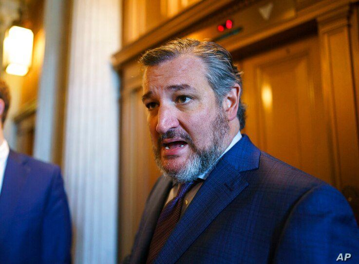 FILE - In this Aug. 5, 2021, file photo, Sen. Ted Cruz, R-Texas, leaves after a Republican luncheon, at the Capitol in…