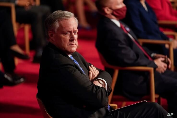 White House Chief of Staff Mark Meadows waits in his seat for the start of the first presidential debate Tuesday, Sept. 29,…