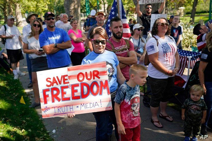 An anti-mask rally outside of the Utah Governors Mansion, Sept. 12, 2020, in Salt Lake City.