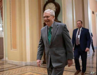 Senate Majority Leader Mitch McConnell, R-Ky., walks to the Senate chamber at the Capitol in Washington, Thursday, Feb. 13,…