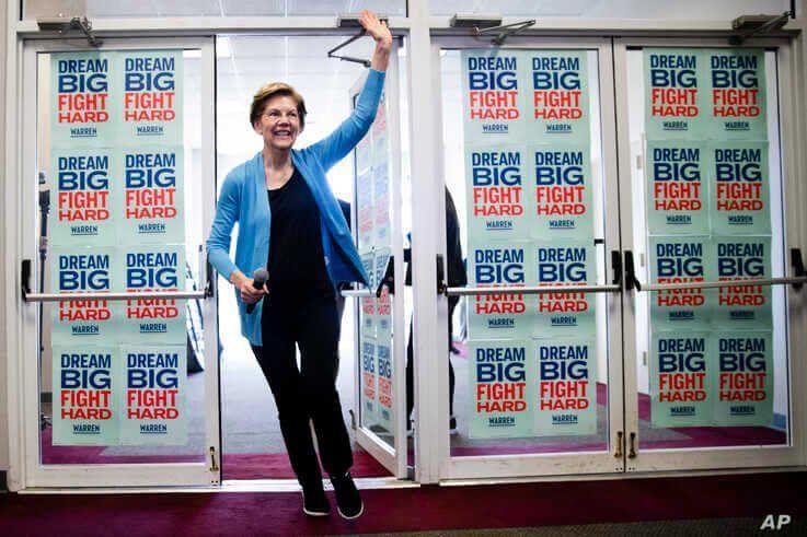 Democratic presidential candidate Sen. Elizabeth Warren, D-Mass., waves to supporters and volunteers, Feb. 29, 2020, in S.C.