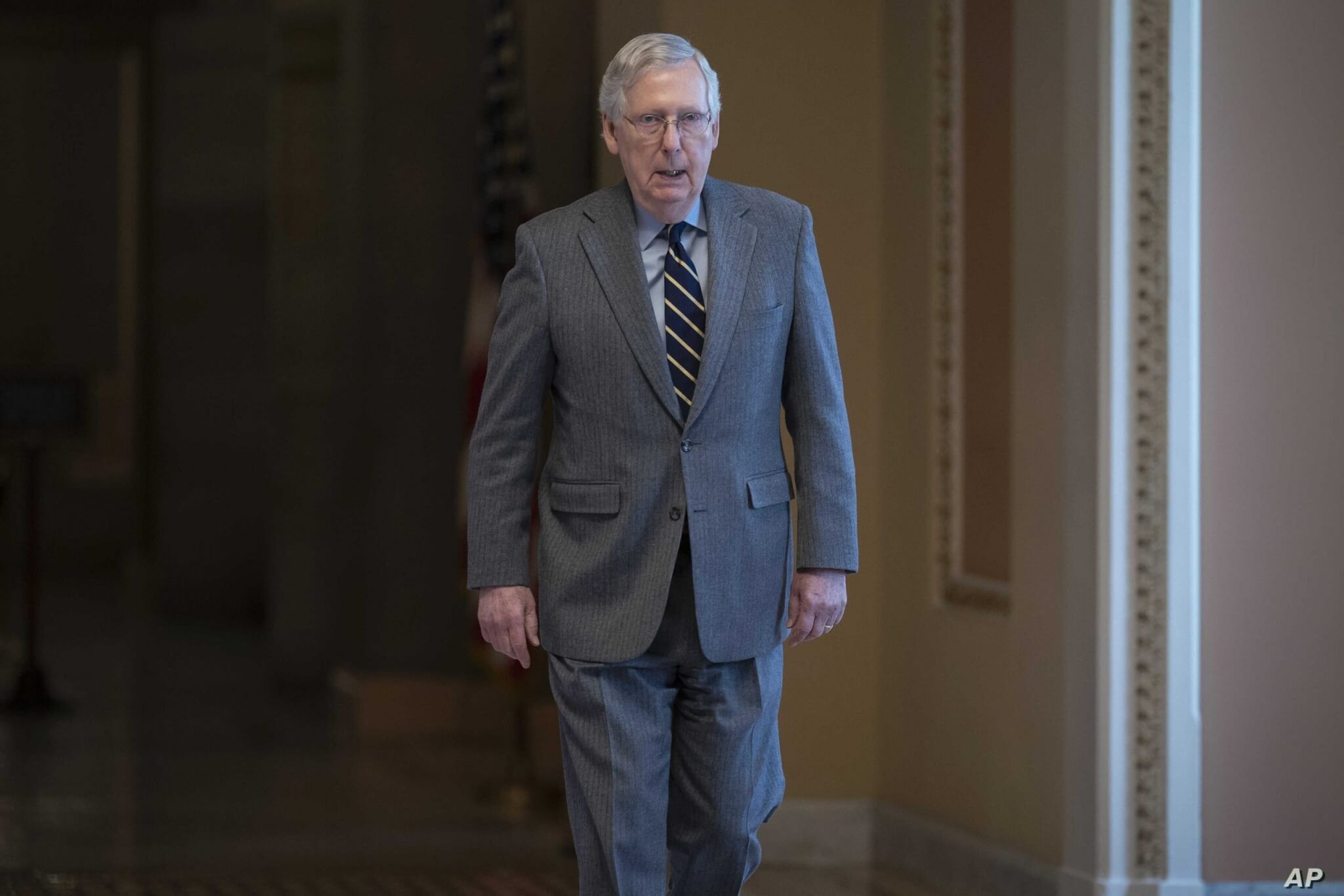 Senate Majority Leader Mitch McConnell, R-Ky., walks to the chamber for a vote on a measure to help tackle the coronavirus…