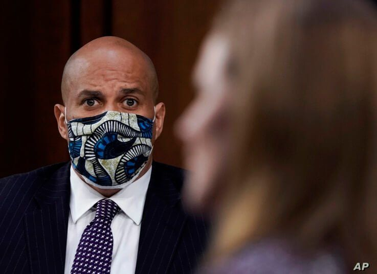 Sen. Cory Booker, D-N.J., listens during the confirmation hearing for Supreme Court nominee Amy Coney Barrett, before the…