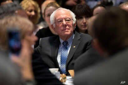 Democratic presidential candidate Sen. Bernie Sanders, I-Vt., listens as he is introduced during the Politics & Eggs at New…