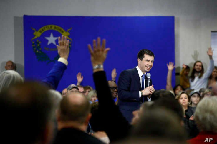 Democratic presidential candidate, former South Bend, Ind., Mayor Pete Buttigieg speaks as attendees raise their hands to ask…