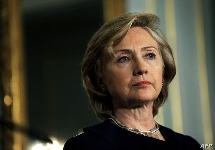 US Secretary of State Hillary Rodham Clinton looks toward the press during a a press conference with Britain's Foreign…