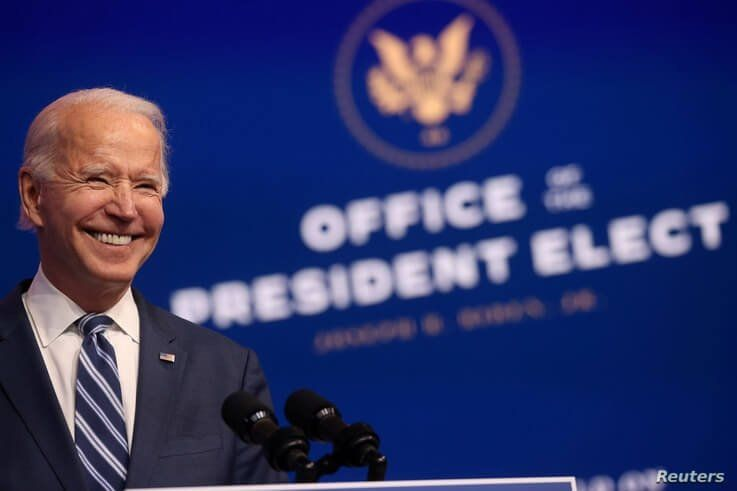 U.S. President-elect Joe Biden smiles as he speaks about health care and the Affordable Care Act (Obamacare) at the theater…