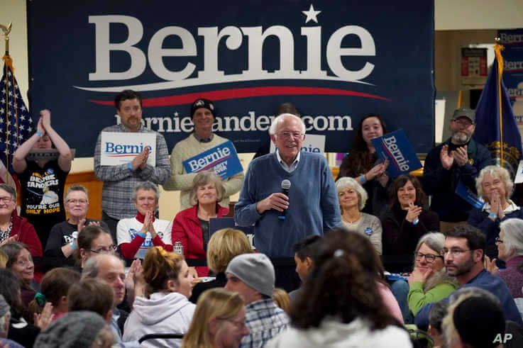 Democratic presidential candidate Sen. Bernie Sanders, I-Vt., smiles as he listens to a question from the audience during a…