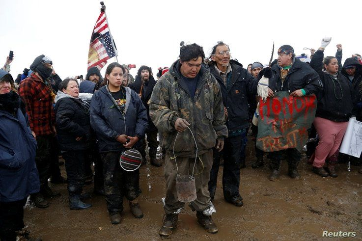 Protesters pray during a rally against the Dakota Access oil pipeline, near Cannon Ball, North Dakota, Feb. 22, 2017.