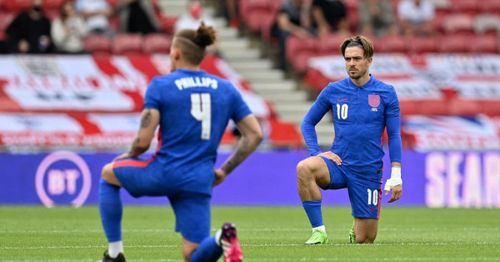 Fans boo players on England's men's national soccer team for kneeling before games