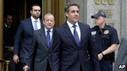 President Donald Trump's personal attorney Michael Cohen (R) and his attorney Stephen Ryan (2nd-L) leave Federal Court, in New York, May 30, 2018.