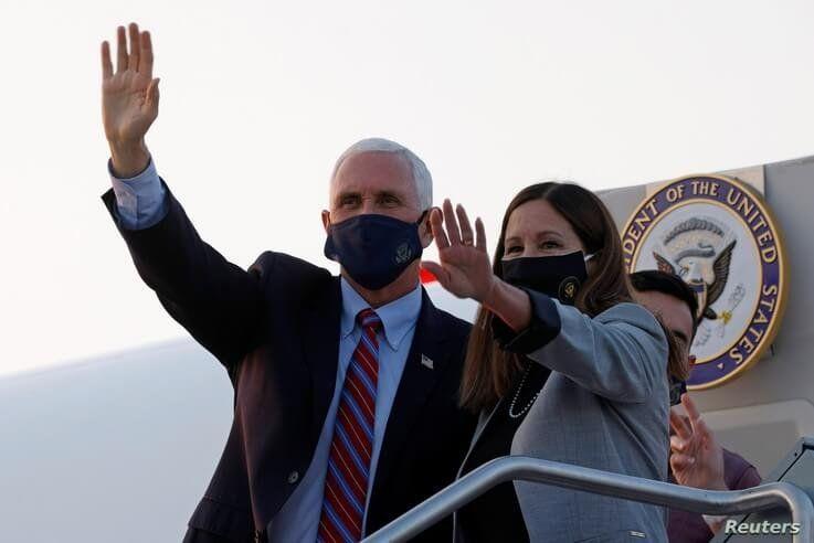U.S. Vice President Mike Pence and his wife Karen arrive ahead of the vice presidential debate in Salt Lake City, Utah, U.S.,…