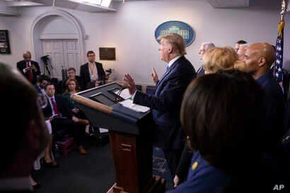 President Donald Trump speaks during a briefing about the coronavirus in the James Brady Press Briefing Room of the White House, Sunday, March 15, 2020, in Washington.