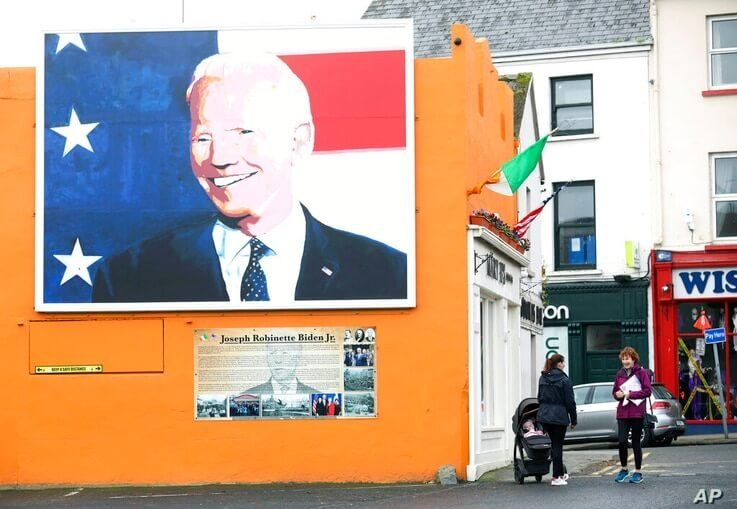 A mural of US Presidential candidate Joe Biden on a gable wall in Ballina, west of Ireland, Wednesday, Nov. 4, 2020. Ballina is…