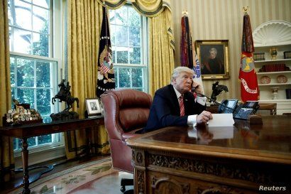 FILE - U.S. President Donald Trump is seen during a phone call at the Oval Office of the White House, in Washington, June 27, 2017.