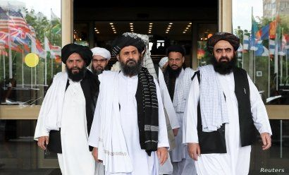 Members of a Taliban delegation, led by chief negotiator Mullah Abdul Ghani Baradar, center, leave after peace talks with Afghan senior politicians in Moscow, May 30, 2019.