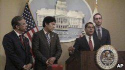 Assemblyman Miguel Santiago, D-LA, second from right, speaks at a news conference at the state Capitol as Assemblyman Rob Bonta, D-Oakland, from left, Sen. Kevin de Leon, D-LA, and Sen. Scott Wiener, D-San Francisco, listen in Sacramento, California, July 5, 2018.