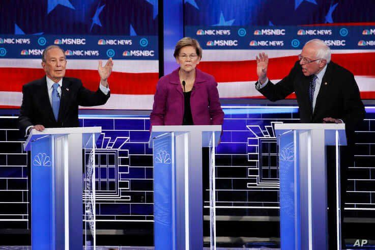 From left, Democratic presidential candidates, former New York City Mayor Mike Bloomberg, Sen. Elizabeth Warren, D-Mass., Sen…