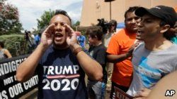 """FILE - A man who called himself a citizen taxpayer, left, argues with protesters at a a rally to oppose a new Texas """"sanctuary cities"""" bill that aligns with the president's tougher stance on illegal immigration, June 26, 2017, in San Antonio, outside of t"""