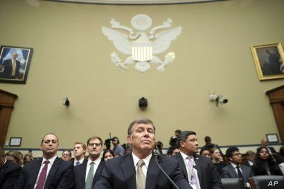 Acting Director of National Intelligence Joseph Maguire takes his seat before testifying before the House Intelligence Committee on Capitol Hill in Washington, Sept. 26, 2019.