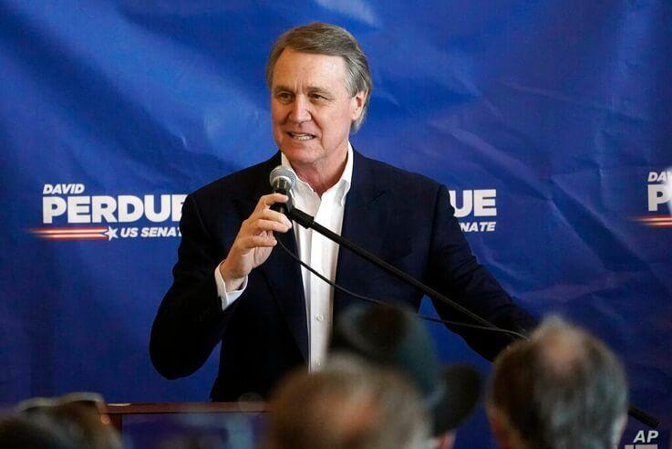 Republican candidate for Senate Sen. David Perdue speaks during a campaign stop at Peachtree Dekalb Airport Monday, Nov. 2,…