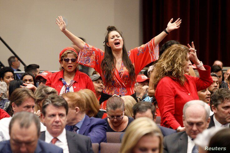 A member of the audience stands at an Evangelicals for Trump Coalition Launch at the King Jesus International Ministry in Miami, Florida, January 3, 2020.