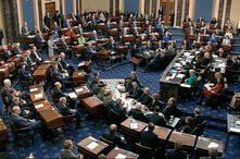 In this image from video, senators vote on the first article of impeachment during the impeachment trial of President Donald Trump, in the Senate at the U.S. Capitol in Washington, Feb. 5, 2020.
