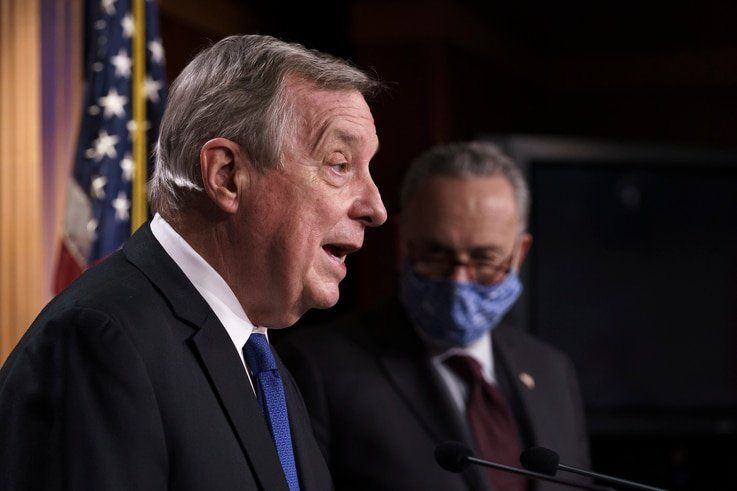 Sen. Dick Durbin, D-Ill., the majority whip, joined at right by Senate Majority Leader Chuck Schumer, D-N.Y., takes a question…