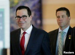 FILE - U.S. Treasury Secretary Steven Mnuchin is seen as he and a U.S. delegation member for trade talks with China, leave a hotel in Beijing, China, May 3, 2018.