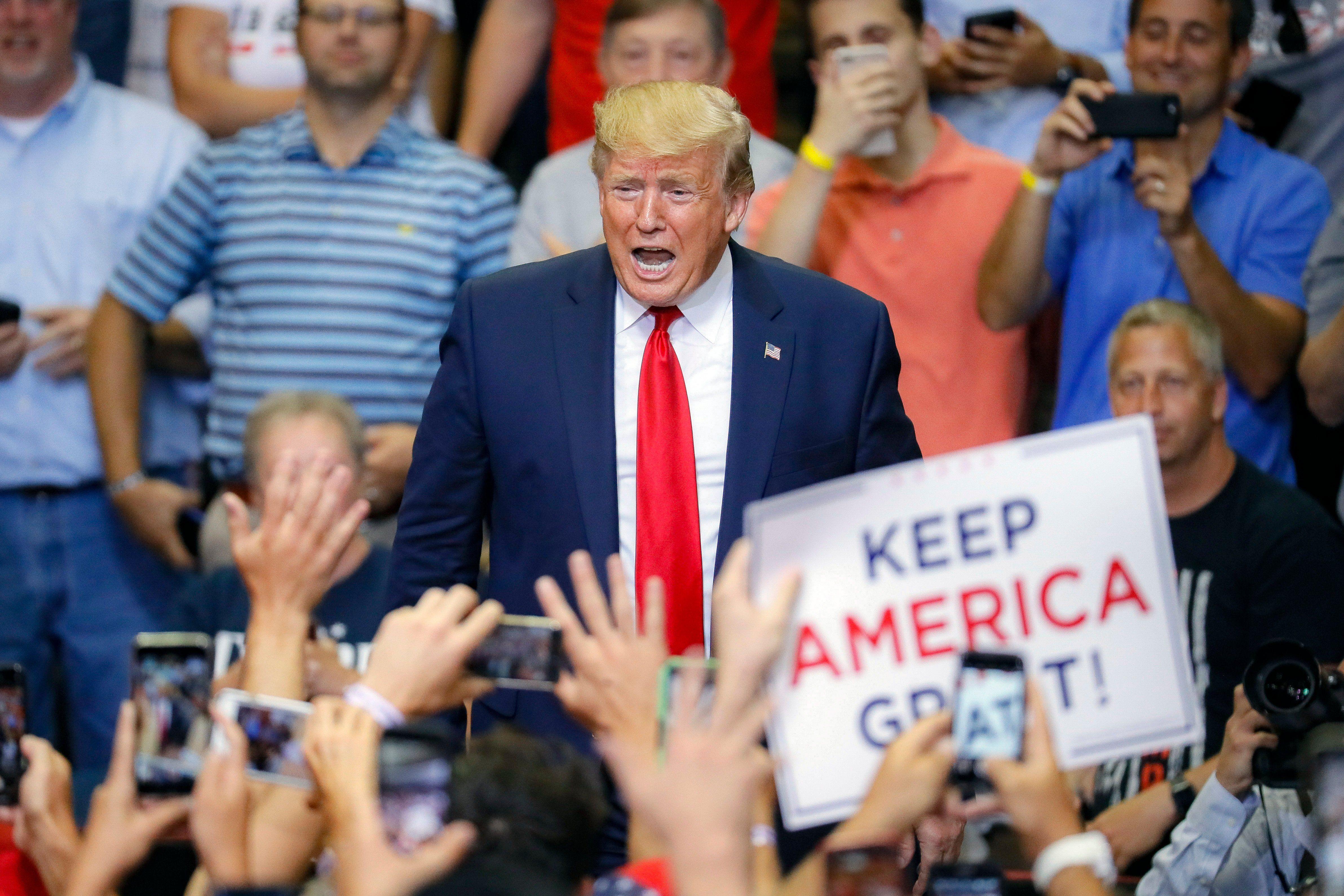 President Donald Trump arrives at a campaign rally at U.S. Bank Arena, Thursday, Aug. 1, 2019, in Cincinnati. (AP Photo/John Minchillo)