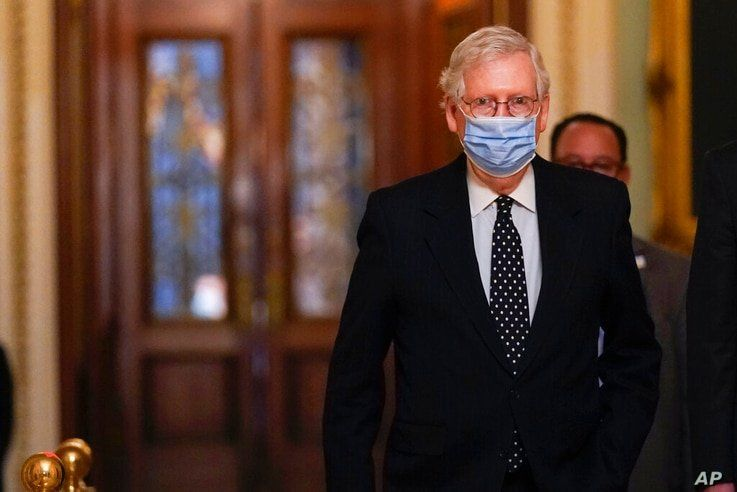 In this Jan. 6, 2021, photo, Senate Majority Leader Mitch McConnell of Ky., walks from the Senate floor to his office on…