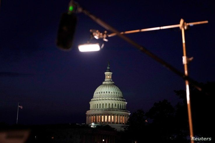 Television lighting is set up near the U.S. Capitol as U.S. President Joe Biden delivers his first address to a joint session of the U.S. Congress in Washington