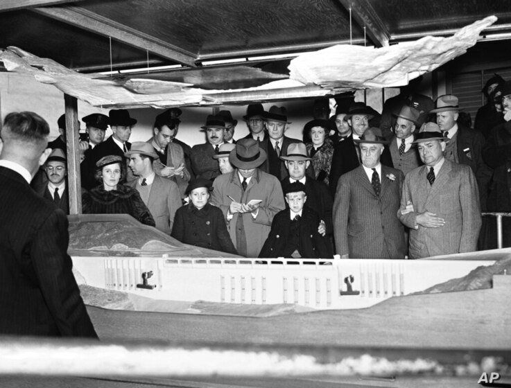 President Franklin D. Roosevelt gets an engineer?s idea of enormous Grand Coulee dam from a model of the structure, Oct. 2,…